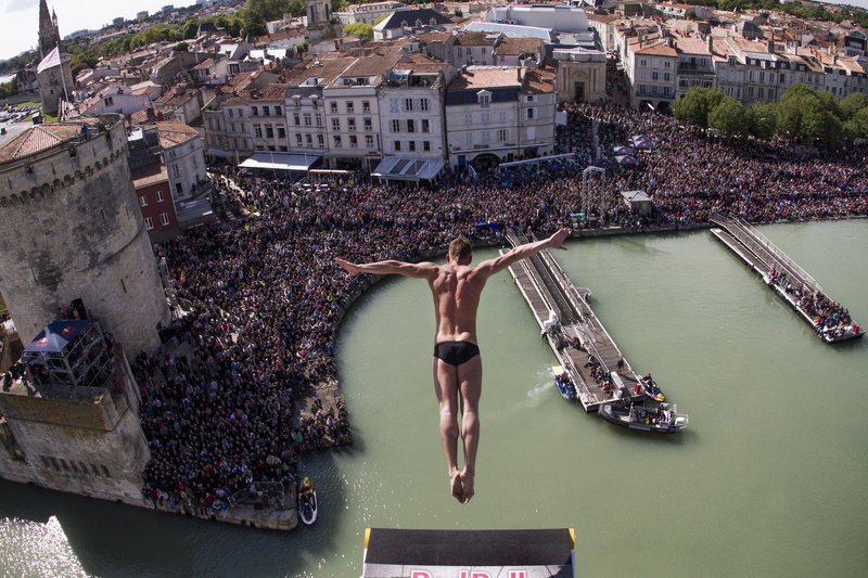 Artem Silchenko of Russia dives from the 27.5 metre platform on the Saint Nicolas Tower during the first stop of the Red Bull Cliff Diving World Series, La Rochelle, France on May 25th 2013.   // Romina Amato/Red Bull Content Pool // P-20130525-00324 // Usage for editorial use only // Please go to www.redbullcontentpool.com for further information. //